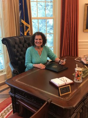 Evelyn Kanter sits at re-creation of Oval Office desk
